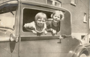 Pauline Henson with her friend Phyllis Ball peaking out of a car
